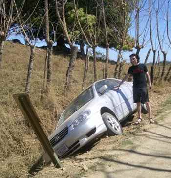 Montezuma Car Rental - This is a photo of my friend Alex, who put his rental car into a ditch because he was driving too fast.  Both he and the car were undamaged.  These roads can be slippery even when they're dry.