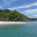 The crystal clear waters of Tortuga Island's best beach