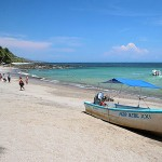 A tour/excursion boat in Montezuma. The boats for tourism have shade.
