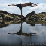 Yoga pose reflected in a tidepool